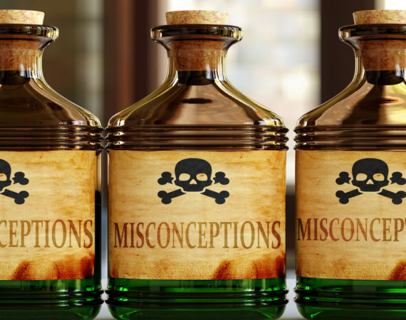 Misconceptions can be like a deadly poison - pictured as word Misconceptions on toxic bottles to symbolize that Misconceptions can be unhealthy for body and mind, 3d illustration